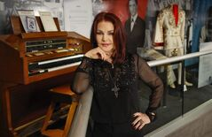 Priscilla Presley stands in the