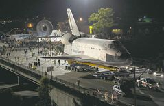 The space shuttle Endeavour is slowly moved across Interstate 405 by a Toyota Tundra on its way to the California Science Center in Los Angeles.