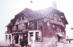 The house took a beating on D-Day, as this photo taken a few days after the battle illustrates.