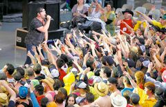 Hardy Countryfest fans enjoy Lee Brice's performance despite the rain Friday evening.