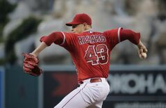 Los Angeles Angels starting pitcher Garrett Richards throws against the Boston Red Sox during the fifth inning of a baseball game on Saturday, Aug. 9, 2014, in Anaheim, Calif. (AP Photo/Jae C. Hong)