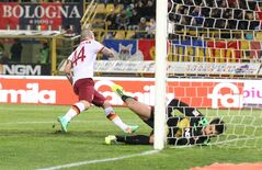AS Roma's Radja Nainggolan scores a goal during the Italian Serie A soccer match between Bologna and Roma at Renato Dall' Ara stadium in Bologna, Italy, Saturday, Feb. 22, 2014. (AP Photo/Studio FN)