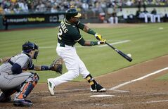 Oakland Athletics' Yoenis Cespedes hits a three-run home run against the Houston Astros during the second inning of a baseball game on Wednesday, July 23, 2014, in Oakland, Calif. (AP Photo)