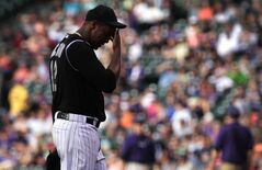 Colorado Rockies starting pitcher Juan Nicasio walks to the dugout in the first inning of a baseball game against the Atlanta Braves in Denver on Tuesday, June 10, 2014. The Braves scored seven runs off Nicasio in the inning. (AP Photo/Joe Mahoney)