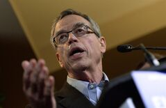 Finance Minister Joe Oliver speaks to media prior to holding a Summer Policy Retreat in Wakefield, Que., on Tuesday, Aug. 12, 2014. Finance Canada has issued a rebuttal of a politically embarrassing report on middle-class economic woes that was compiled last fall by experts in another federal department. THE CANADIAN PRESS/Sean Kilpatrick