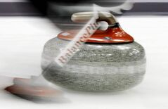 A slow camera shutter speed blurrs a Ontario curling stone as it speeds down the ice a during an afternoon against New Brunswick draw at the Tim Hortons Brier in Saskatoon, Sask., Sunday, March, 3, 2012.  THE CANADIAN PRESS/Jonathan Hayward
