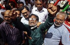 Bangladeshi activists shout slogans as they protest against the verdict of former Jamaat-e-Islami leader Ghulam Azam in Dhaka, Bangladesh, Monday, July 15, 2013. The 91-year-old former chief of the Islamic party in Bangladesh was sentenced to 90 years in jail on Monday for crimes against humanity during the country's 1971 independence war, angering both supporters who said the trial was politically motivated and opponents who said he should be executed. (AP Photo/A.M. Ahad)