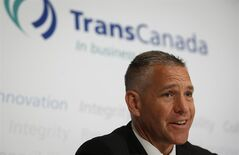 TransCanada CEO Russ Girling speaks to reporters following the company's annual meeting in Calgary, Friday, May 2, 2014. THE CANADIAN PRESS/Jeff McIntosh