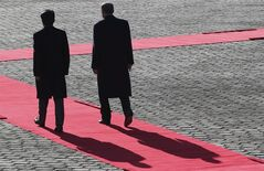 Turkish Prime Minister Recep Tayyip Erdogan, center, and Japanese Prime Minister Shinzo Abe attend a welcome ceremony at Akasaka State Guest House in Tokyo, Tuesday, Jan. 7, 2014. (AP Photo/Koji Sasahara)