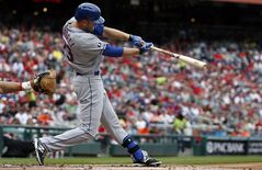 New York Mets' Eric Campbell (29) hits a two-run single during the first inning of a baseball game against the Washington Nationals at Nationals Park Saturday, May 17, 2014, in Washington. (AP Photo/Alex Brandon)