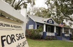 FILE- In this March 7, 2014, file photo, a realty sign hangs in front of a home for sale in Orlando, Fla. Standard & Poor's releases the S&P/Case-Shiller index of home prices for April on Tuesday, June 24, 2014. (AP Photo/John Raoux, File)