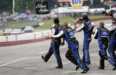 Chris Buescher's Roush Fenway crew celebrates after he crossed the finish line to win the NASCAR Nationwide Series Nationwide Children's Hospital 200 auto race at Mid-Ohio Sports Car Course, Saturday, Aug. 16, 2014, in Lexington, Ohio. (AP Photo/Tom E. Puskar)