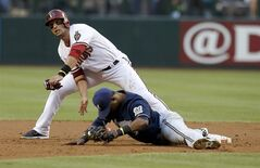 Arizona Diamondbacks' Martin Prado, left, collides with Milwaukee Brewers' Jean Segura after Prado was forced out at second base during the first inning of a baseball game on Tuesday, June 17, 2014, in Phoenix. (AP Photo/Ross D. Franklin)