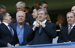 England's national team manager Roy Hodgson, centre waits for the start of a Champions League semifinal second leg soccer match between Chelsea and Atletico Madrid at Stamford Bridge Stadium in London Wednesday, April 30, 2014. (AP Photo/Kirsty Wigglesworth)