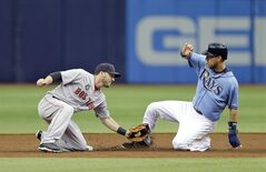 Boston Red Sox shortstop Stephen Drew, left, tags out Tampa Bay Rays' Ben Zobrist who was attempting steal second base during the first inning of a baseball game Sunday, July 27, 2014, in St. Petersburg, Fla. (AP Photo/Chris O'Meara)