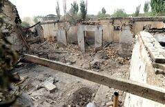 FILE - In this April 25, 2013 file photo, houses destroyed in a violent clash are left in Kashgar, in China's northwestern region of Xinjiang. Police have arrested more suspects in connection with a clash between authorities and assailants that left 21 dead in the western region of Xinjiang, Chinese state media reported Monday, April 29, 2013. (AP Photo/Kyodo News) JAPAN OUT, MANDATORY CREDIT