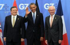 U.S. President Barack Obama, center, waves as he is welcomed by European Commission President Jose Manuel Barroso, left, and European Council President Herman Van Rompuy during arrivals for a G7 summit at the EU Council building in Brussels on Wednesday, June 4, 2014. The leaders of the Group of Seven will participate in a two day meeting in which they will discuss among other issues, the situation in Ukraine. (AP Photo/Yves Logghe)
