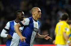 FC Porto's Maicon Roque from Brazil celebrates after scoring the opening goal against Estoril during their Portuguese League soccer match at the Dragao Stadium in Porto, Portugal, Friday, March 8, 2013. At left is Jackson Martinez, from Colombia, who scored their second goal. (AP Photo/Paulo Duarte)