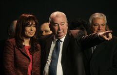 FILE - In this Aug. 20, 2009 file photo, Argentina's President Cristina Fernandez looks as Julio Grondona, president of the Argentine Football Association, (AFA), points, after signing an agreement on the government's takeover of the television rights for soccer games, in Buenos Aires, Argentina. Grondona, who died Wednesday, July 30, 2014, from a heart problem, served as president of the AFA since 1979, and vice president of FIFA since 1988. (AP Photo/Natacha Pisarenko, File)