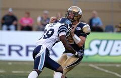 Winnipeg Blue Bombers' quarterback Buck Pierce is hit by Toronto Argonauts' Brandon Isaac Saturday at Canad Inns Stadium. The Argos beat the Bombers 29-10.