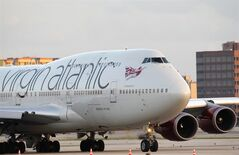 A Virgin Atlantic Boeing 747-400 taxis at Miami International Airport, Oct. 11, 2012 in Miami. THE CANADIAN PRESS/AP, Wilfredo Lee