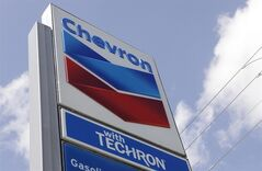 This July 25, 2011 photo shows a Chevron sign at a gas station in Miami. THE CANADIAN PRESS/AP, Lynne Sladky