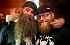 Don McPhail (left) and Nathan Terin show off contrasting styles of beard at an evening meeting of the Manitoba Facial Hair Club.