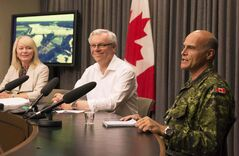 Premier Greg Selinger and MP Candace Bergen thank Brig.-Gen. Christian Juneau and the Canadian Forces for their assistance with the floods.