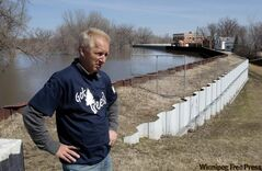 Emerson Mayor Wayne Arseny on the dike protecting the town as the Red River nears its crest Monday.