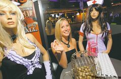 Carmen Penner, caller at the  Headingley Hotel's erotic bingo, with some of the naughty prizes  up for grabs.