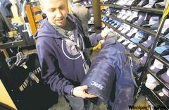 St. Vital Centre Jets Gear store manager James Scott displays Evander Kane's hockey pants, now for sale.