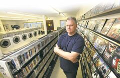 Video 1001 manager Ken Taylor. The video store may soon disappear, replaced by online or pay-per-view options for watching movies.