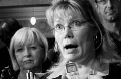 Tory MP Shelly Glover, right, flanked by MP Joy Smith, said her party deserves credit for immigrant settlement.