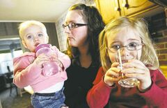 Nicole Bowering's two girls, Cadence, 4, and Alice, 18 months, drink some clean tap water.