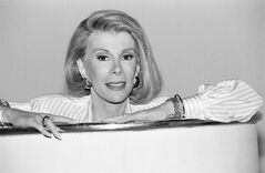 FILE - In this Aug. 15, 1989 file photo ,Joan Rivers announces that she is starting a new syndicated talk show,