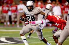 Utah State running back Joey DeMartino runs against the New Mexico defense in the first half of an NCAA college football game, Saturday, Oct. 19, 2013, at University Stadium in Albuquerque, N.M. Utah State won 45-10. (AP Photo/Eric Draper)