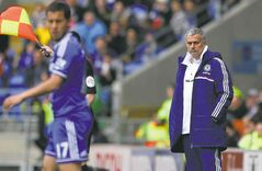 Chelsea manager Jose Mourinho looks at Eden Hazard of Chelsea Barclays Premier League.