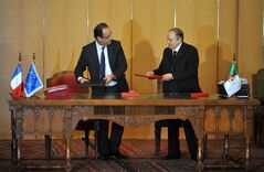 French President Francois Hollande, left and Algerian President Abdelaziz Bouteflika exchange contracts in Algiers, Wednesday, Dec. 19, 2012. Commercial contracts, particularly in the food and agriculture areas, were signed along with an agreement to an assembly plant of Renault vehicles, near Oran, Algeria. Hollande arrived Wednesday on a state visit to Algeria, hoping for a clean start in relations after a half-century of tensions with this North Africa nation, once the French empire's most prized colony. (AP Photo/Djarboub Sidali )