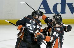 Anaheim Ducks celebrate a goal by Nick Bonino against the Los Angeles Kings during the first period in Game 5 of an NHL hockey second-round Stanley Cup playoff series in Anaheim, Calif., Monday, May 12, 2014. (AP Photo/Chris Carlson)