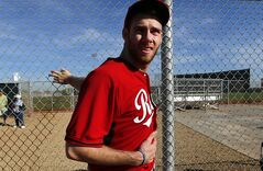 Cincinnati Reds pitcher Tony Cingrani stretches during spring training baseball practice in Goodyear, Ariz., Saturday, Feb. 15, 2014. (AP Photo/Paul Sancya)