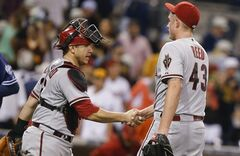 Arizona Diamondbacks closer Addison Reed is congratulated by catcher Miguel Montero after the Diamondabcks' 3-1 victory over the San Diego Padres in a baseball game Saturday, June 28, 2014, in San Diego. Montero supplied the difference in the Diamondbacks' victory with a two-run home run. (AP Photo/Lenny Ignelzi)