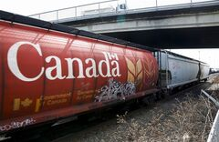 A Canadian Pacific Rail train hauling grain passes through Calgary, Thursday, May 1, 2014. A rail bottleneck that left grain sitting in bins across the Prairies has prompted Ottawa to move up a statutory review of transportation legislation. THE CANADIAN PRESS/Jeff McIntosh