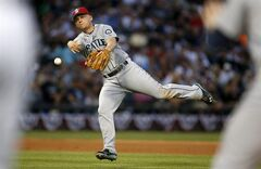 Seattle Mariners third baseman Kyle Seager is late on the throw to first on a single hit by Chicago White Sox's Dayan Viciedo during the eighth inning of a baseball game on Friday, July 4, 2014, in Chicago. (AP Photo/Andrew A. Nelles)