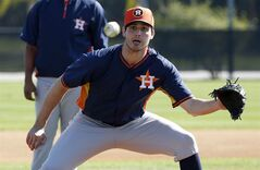 Houston Astros pitcher Mark Appel prepares to field a ball during baseball spring training Wednesday, Feb. 19, 2014, in Kissimmee, Fla. (AP Photo/Alex Brandon)