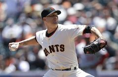 San Francisco Giants pitcher Tim Hudson throws against the Washington Nationals during the first inning of a baseball game in San Francisco, Thursday, June 12, 2014. (AP Photo/Jeff Chiu)
