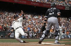 San Francisco Giants' Joe Panik, left, scores past Chicago White Sox catcher Tyler Flowers (21) on Angel Pagan's single during the seventh inning of a baseball game in San Francisco, Wednesday, Aug. 13, 2014. (AP Photo/Jeff Chiu)