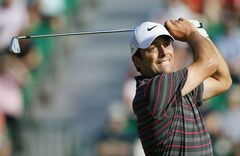 Francesco Molinari of Italy plays a shot off the 4th tee during the first day of the British Open Golf championship at the Royal Liverpool golf club, Hoylake, England, Thursday July 17, 2014. (AP Photo/Alastair Grant)
