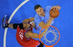 Los Angeles Clippers forward Blake Griffin, right, puts up a shot as Philadelphia 76ers forward Evan Turner defends during the first half of an NBA basketball game Sunday, Feb. 9, 2014, in Los Angeles. (AP Photo/Mark J. Terrill)