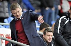 Cardiff City's manager Ole Gunnar Solskjaer gestures, during their English Premier League match against Hull City, at The Cardiff City Stadium, Cardiff, Wales, Saturday Feb. 22, 2014. (AP Photo/PA) UNITED KINGDOM OUT: NO SALES: NO ARCHIVE