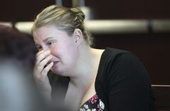 Kristina Hill, neighbor of murder victim Jennifer Martel, wipes tears during a hearing for Jared Remy, son of Boston Red Sox baseball broadcaster Jerry Remy, in Middlesex Superior Court Tuesday, May 27, 2014, in Woburn, Mass. Remy pleaded guilty to first-degree murder and other charges for stabbing his girlfriend Jennifer Martel to death in August 2013, and was immediately given the mandatory sentence of life in prison without parole. (AP Photo/Joanne Rathe, The Boston Globe, Pool)